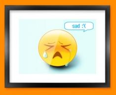 Sad Emoticon Framed Print